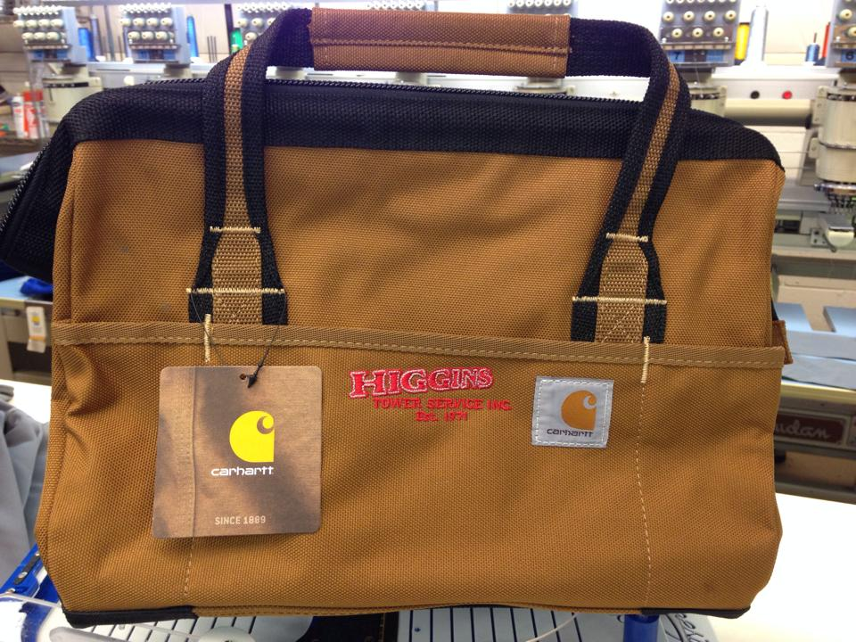 This is a brown bag with the Higgins logo on it.