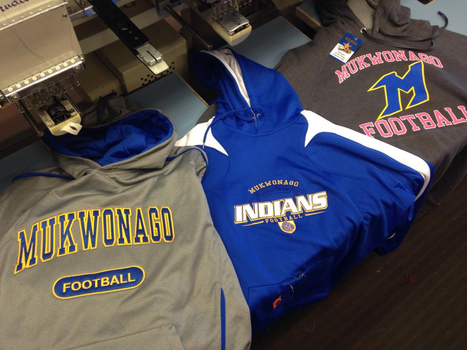 These are three different sweatshirts with the Mukwonago football logo on them.