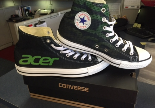These are shoes with the acer logo on them.
