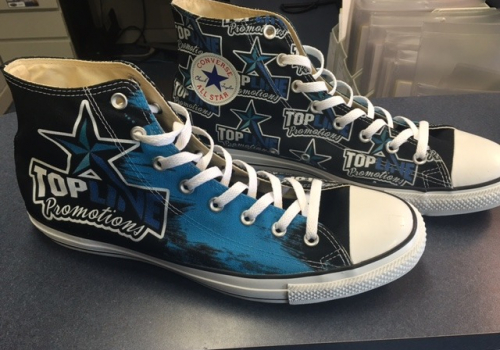 These are shoes that say, Topline Promotion.